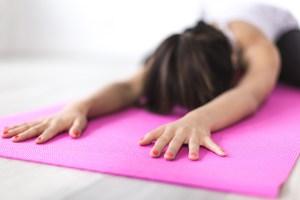 yoga student holding yoga mat