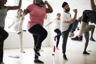 Adults Exercising in Group Fitness Class