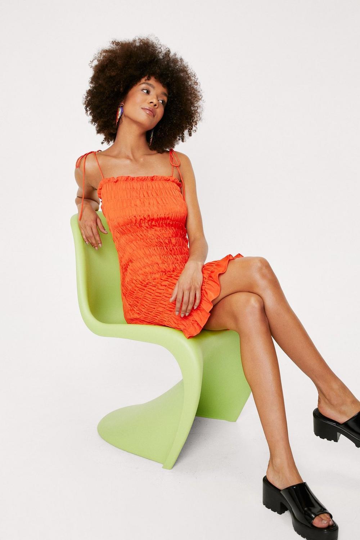 orange shirred bodycon mini dress
