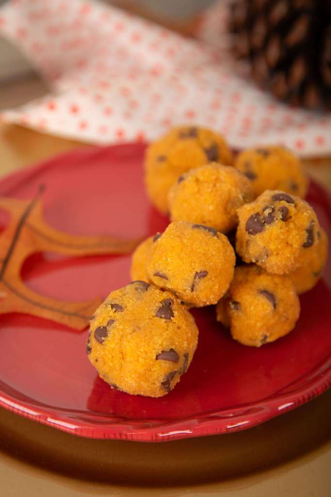 pumpkin cookie dough bites on a red plate