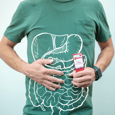 What digestion can look like. A man holding his stomach and a drawn white outline of the body's digestive system.