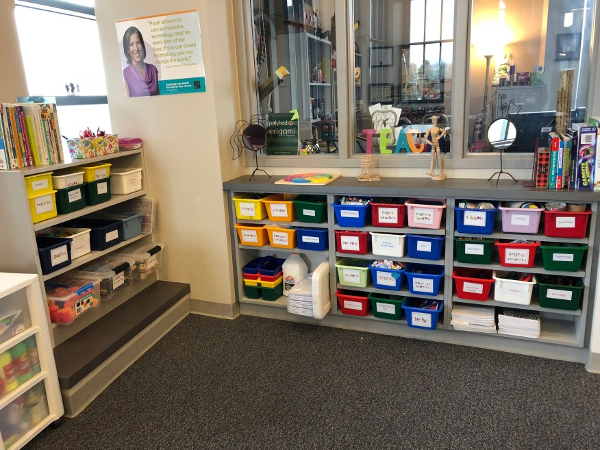 Shelves with supply bins for a maker space