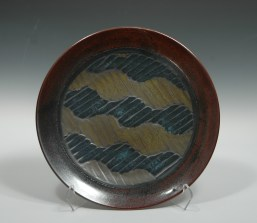 David MacDonald 13.5 inches in diameter Porcelain Plate. Quilt Series. 2013 Decorated with a black vitreous engobe base; with glazes applied over it using wax resist