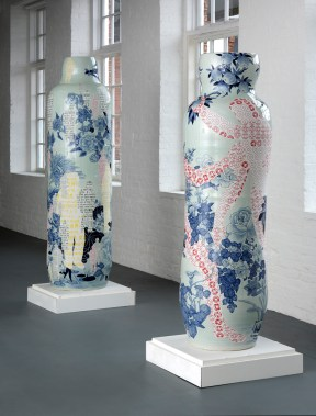 """Sin-ying Ho, left: """"One World, Many Peoples No. 2″ (77 x 23.25″) and right: """"Temptation – Life of Goods No. 2″ (68 x 23.5″) 2010, porcelain, cobalt pigment, underglaze, decal, glaze."""
