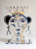 "Mara Superior, ""Wounded Beauty"" 2014, porcelain, cobalt, glaze, gold luster, metal wire, 12 x 15 x 5.5″."