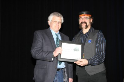 Richard Notkin received an NCECA Award last year, presented by Keith Williams, who is receiving an award this year!
