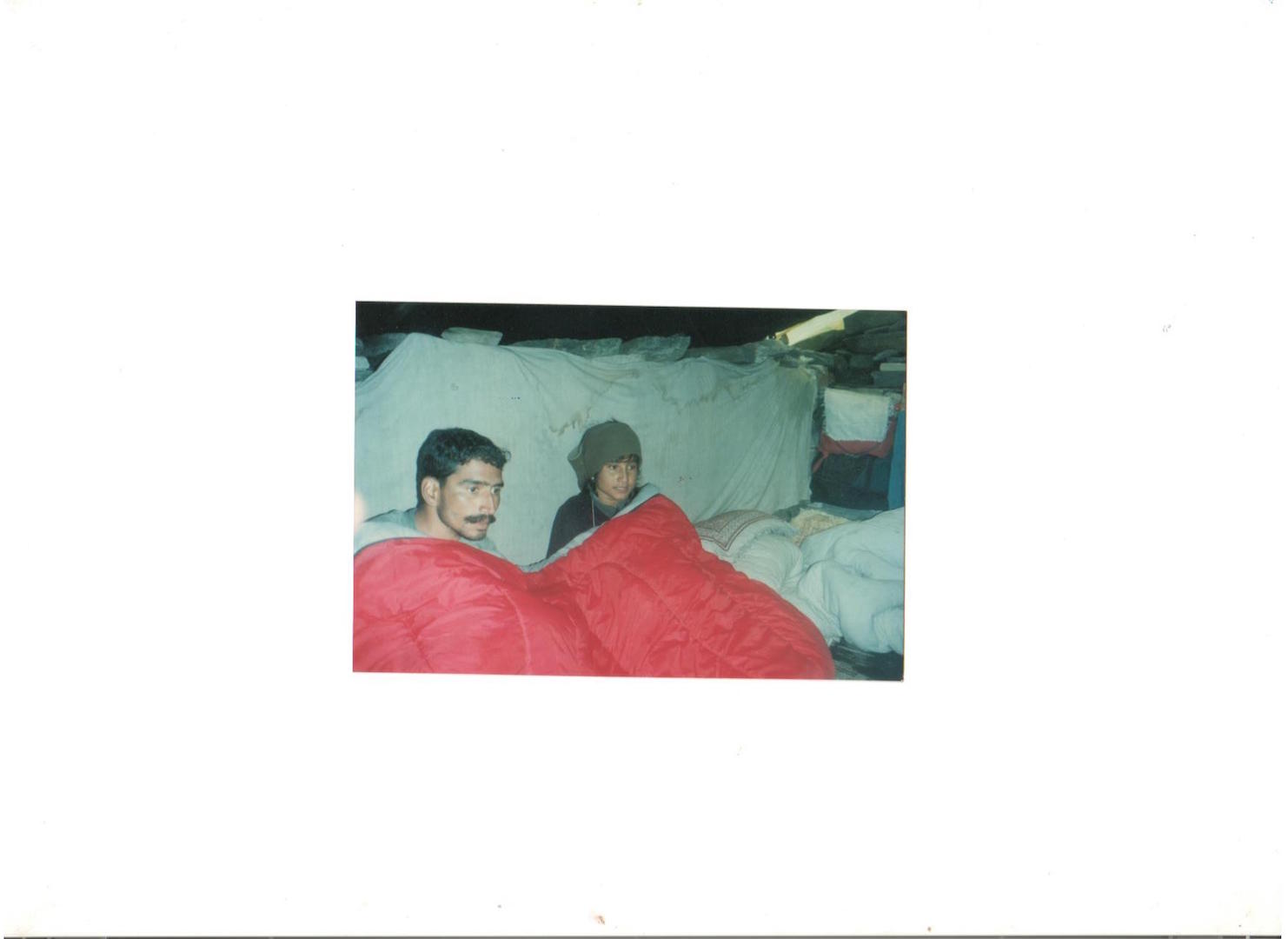 Yash Veer and I at the hut in Dorni with the only dry sleeping bag. On my head is Sridhar's monkey-cap.