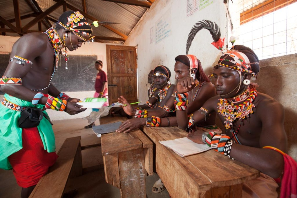 Samburu moran (warrior) learning to how to write. Samburuland, Kenya | Photo by Nelson Guda © 2019