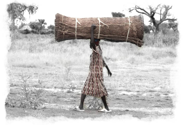 S. Sudan woman walking on road | Photograph by Nelson Guda