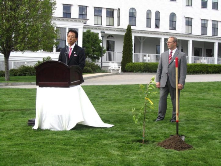 The Japanese Couinsul General makes a few remarks before planting the cherry tree.