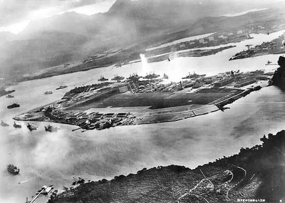 Photograph taken from a Japanese plane during the torpedo attack on ships moored on both sides of Ford Islan
