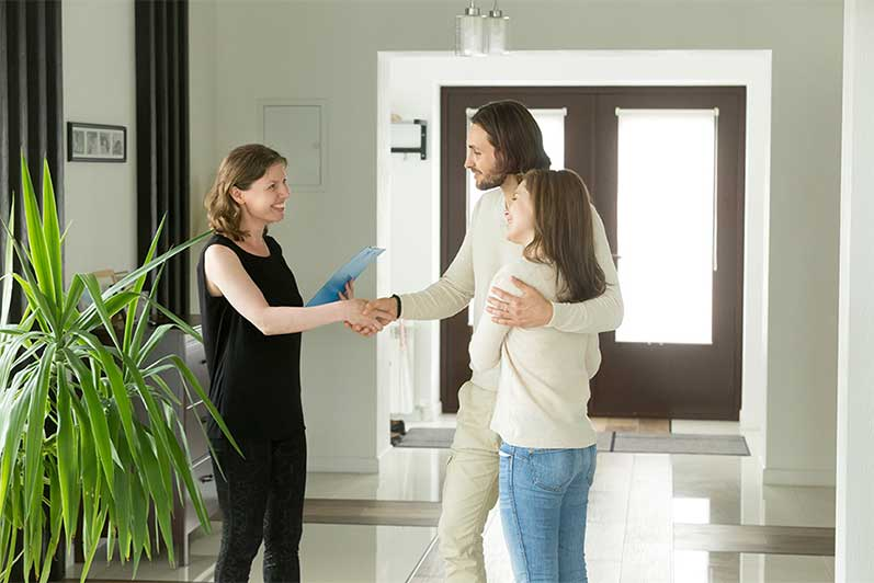 shaking hands with a new real estate agent when selling a home on the seacoast