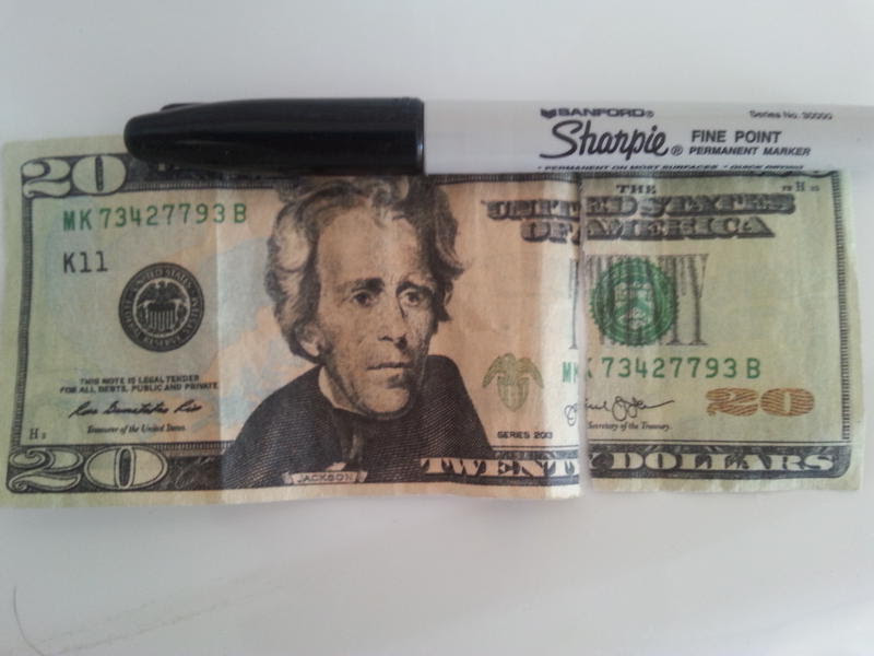 The fake $20 David received at the yard sale. Police later arrested the man who was using them to purchase items.