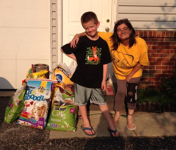 Joanie and her young neighbor, who used all of his birthday money to donate food to the Speedway Animal Rescue.