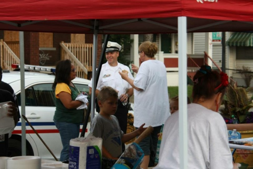 Sherri (right) talking with the local police at one of the many community block watch events .