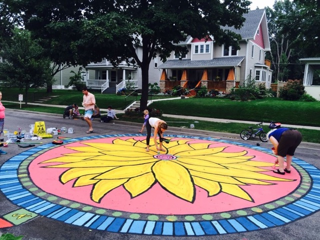 Sarah and neighbors painting the new mural during this year's block party.
