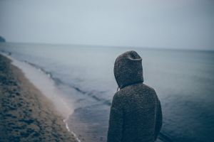 Photo of a person reflecting at the beach
