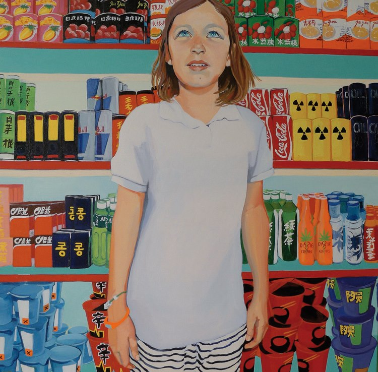 Young girl standing by sweets