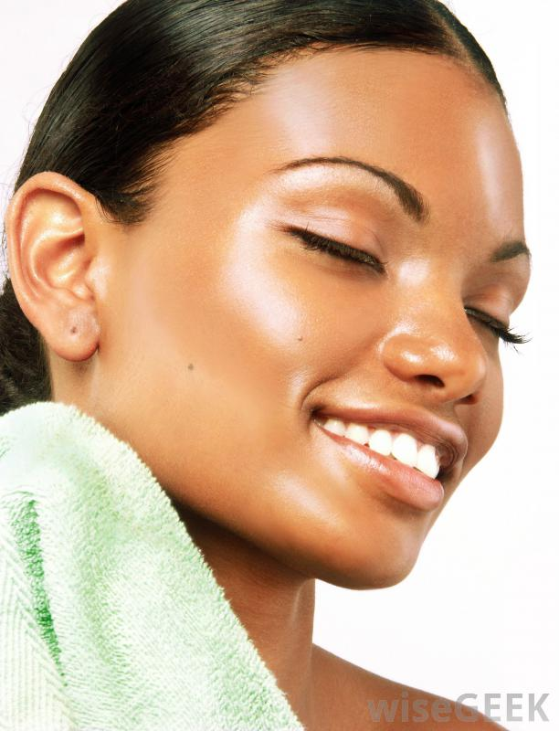 smiling-woman-holding-green-towel