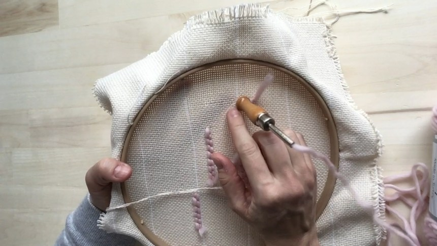 Insert the punch needle until the handle touches the Monks cloth