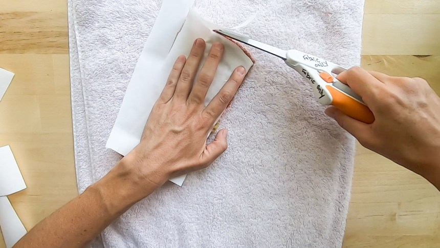 Use the needle punch patch to cut the adhesive paper to size