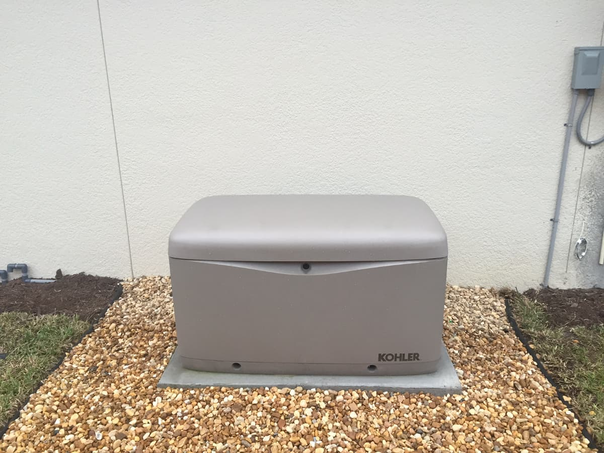hight resolution of kohler standby unit installed on a rock pad