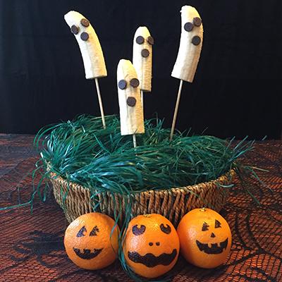 banana_ghosts_orange_jack_o_lanterns