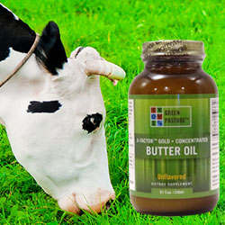 Picture of a cow eating nice green grass next to a bottle of Green Pasture X-Factor Gold High Vitamin Butter Oil.