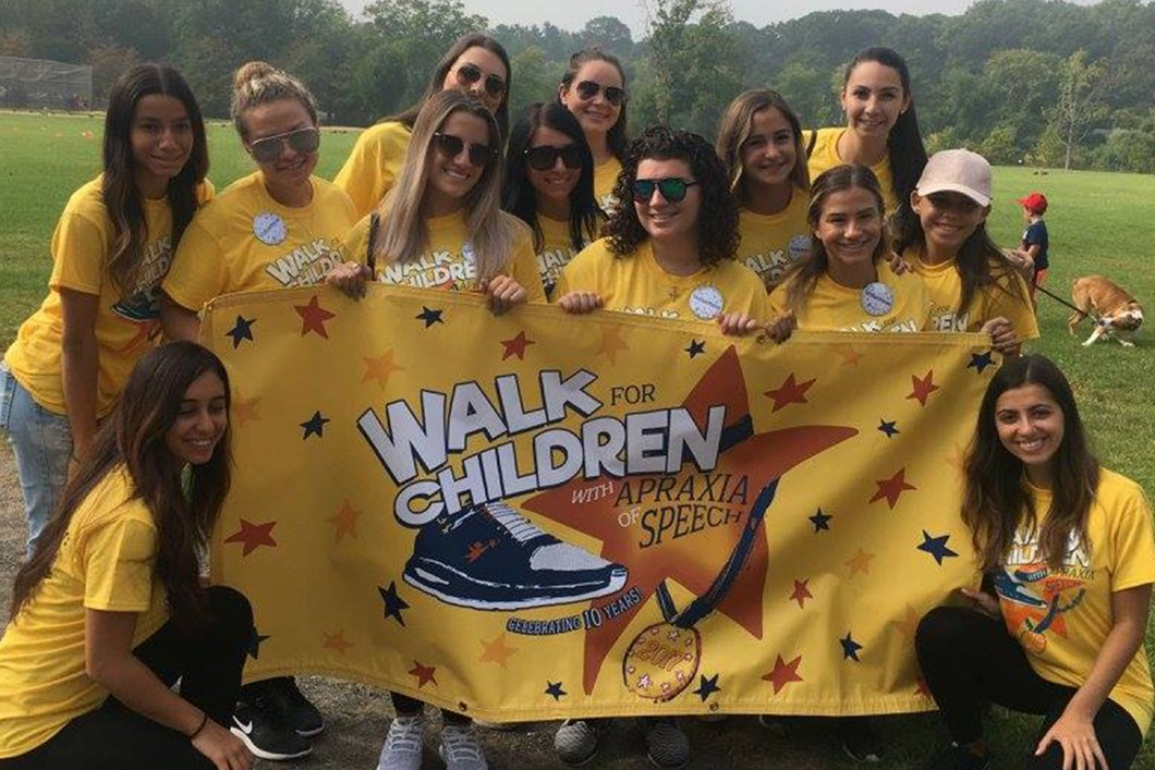 St. John's University, Staten Island, NSSLHA chapter members participating in the Staten Island Speaks Up! walk to raise awareness about childhood apraxia of speech.