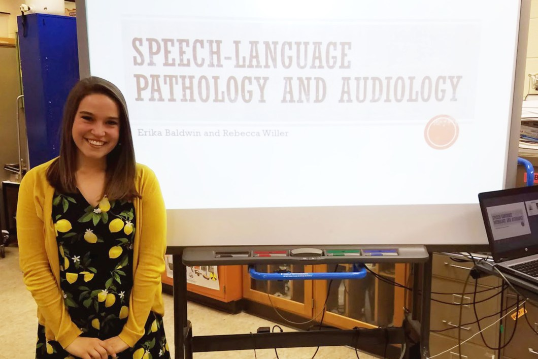 Rebecca Willer presenting to high schooler students about the speech-language pathology and audiology professions.