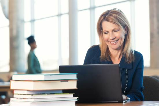 Nontraditional student at laptop