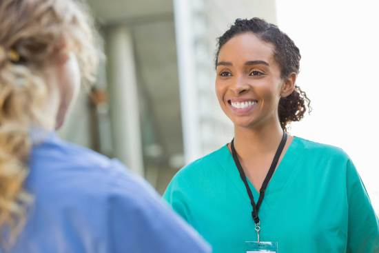 Student wearing scrubs in medical setting
