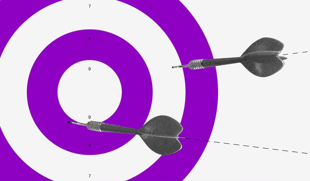 medidas para ajudar micro e pequenas empresas coronavírus: um alvo roxo e branco com dardos sendo atirados nele.