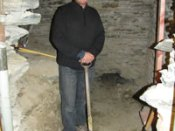 Lakes District Museum director David Clarke stands in the excavated area next to the rediscovered safe room, which was used when the Bank of New Zealand building operated in the post-gold rush decades of Arrowtown. The holes to the safe room are behind Mr Clarke. Photo by James Beech