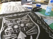 Foo Fest artist in residence Xander Marro's cat face design printed on a bandana by AS220's Print Shop.