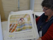 Sue from Kaiapoi Museum rehousing the museum's poster collection.