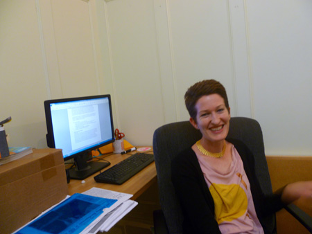 Happy in my work! At my desk in the Dreyfus building, AS220.