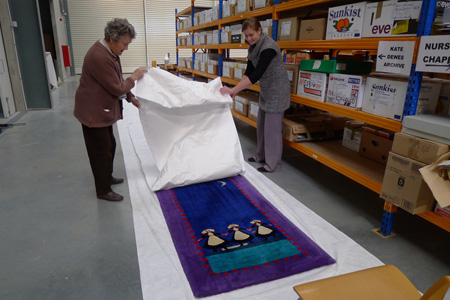 Covering the Chapel's Carpet Runner with Tyvek in preparation for storage 1