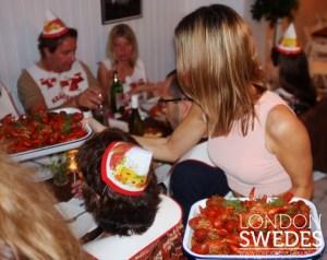 Image of waitress serving crayfish