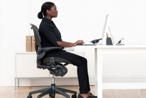 Sit with proper posture in your office chair.
