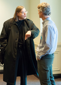 Guillaume Aubert and Gordon Sayre continue a discussion after a panel.