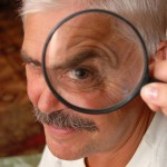 Home Inspector: Image of gentleman holding a magnifying glass