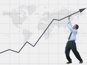 man holding up graph line