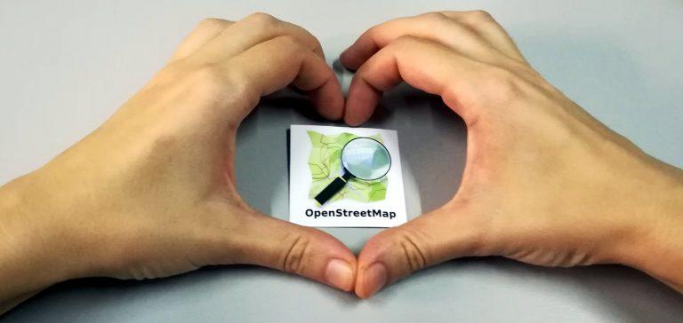 hands_with_OSM_sticker