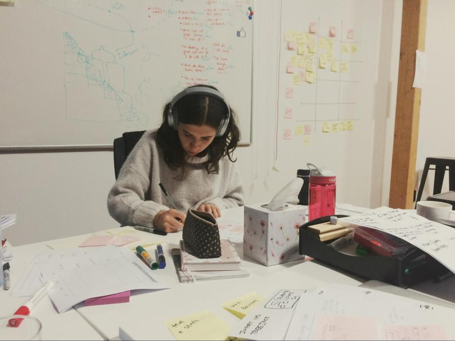 Mila our data scientist sketching intensely during Crazy 8s
