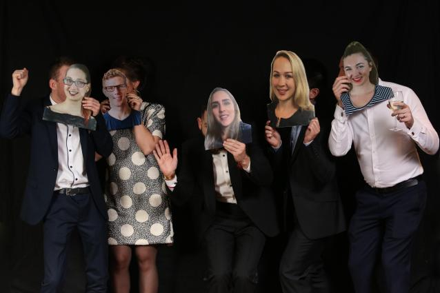 A few of the remote Optimal Workshop team members had cardboard cut outs of their faces at Optimal HQ