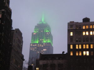 Empire State Building lighted in green, as seen from Bryant Park. (Photo by Jonathan71)