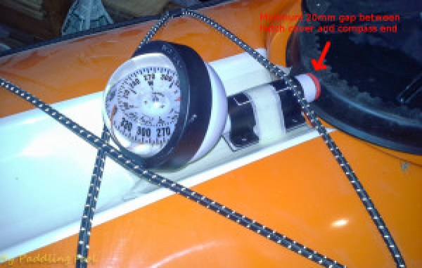 Due to the mast installation fore of the forward hatch the only place left for compass installation was just aft of the forward hatch. One should take in consideration the space needed to remove and close the hatch cover!