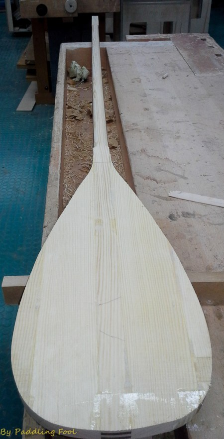 "The paddle blade outline has ben marked and the excess cut off. The blade cheek materil in nordic pine of relative ""light"" growth. ie. not so dense+heavy"