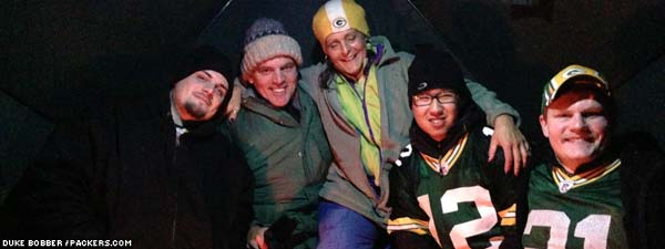 Packers tailgaters from Florida and Wisconsin huddle in a heated tent a few blocks from Lambeau Field.